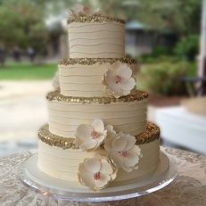 Couture-wedding-cake-magnolia-fondant-flowers-gold-trim
